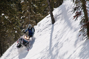 Snowmobiling in mountains
