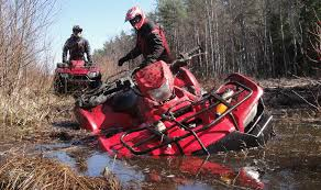 Red ATV Stuck In Mud Pit